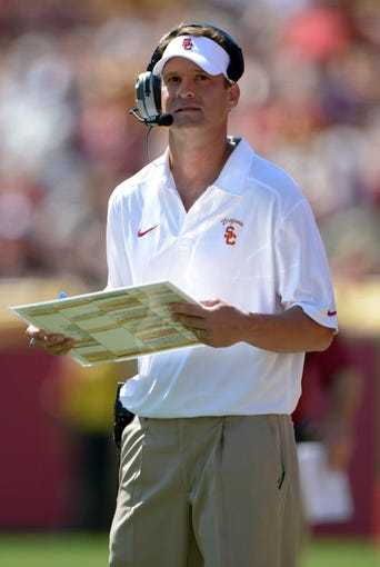 Sep 14, 2013; Los Angeles, CA, USA; Southern California Trojans coach Lane Kiffin reacts during the game against the Boston College Eagles at Los Angeles Memorial Coliseum. USC defeated Boston College 35-7. Mandatory Credit: Kirby Lee-USA TODAY Sports