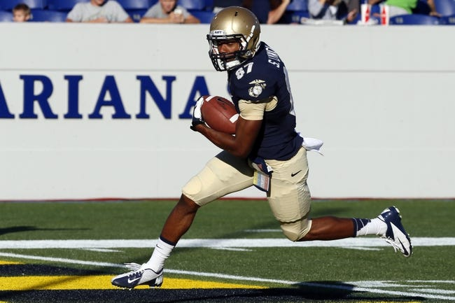 Sep 14, 2013; Annapolis, MD, USA; Navy Midshipmen wide receiver Shawn Lynch (87) runs following his catch for a touchdown against the Delaware Blue Hens at Navy Marine Corps Memorial Stadium. Mandatory Credit: Mitch Stringer-USA TODAY Sports