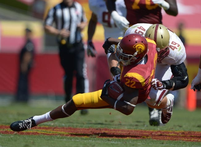 Sep 14, 2013; Los Angeles, CA, USA; Boston College Eagles linebacker Steele Divvitto (49) tackles Southern California Trojans tailback Justin Davis (22) at Los Angeles Memorial Coliseum. USC defeated Boston College 35-7. Mandatory Credit: Kirby Lee-USA TODAY Sports