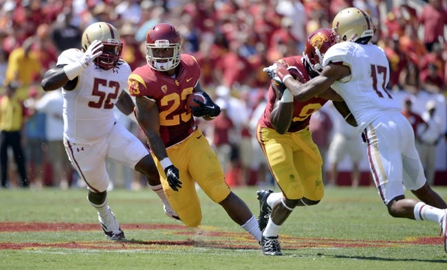 Sep 14, 2013; Los Angeles, CA, USA; USC Trojans running back Tre Madden (23) runs past Boston College Eagles linebacker Steven Daniels (52) and defensive back Bryce Jones (17) on his way to a 16-yard gain in first half action at Los Angeles Memorial Coliseum. Mandatory Credit: Robert Hanashiro-USA TODAY Sports