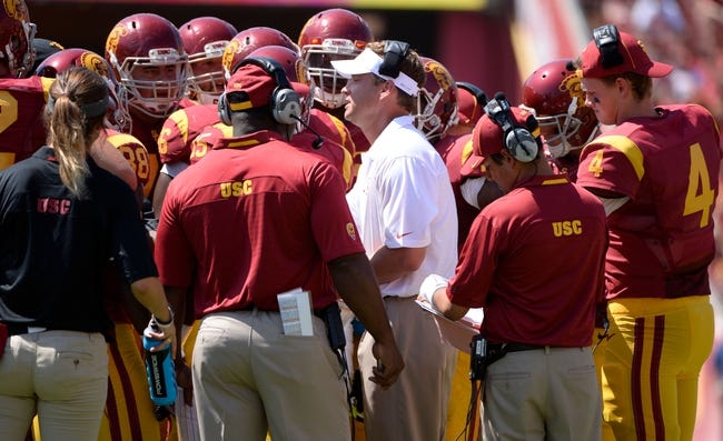 Sep 14, 2013; Los Angeles, CA, USA; USC head coach Lane Kiffin talks to his offense during first half action at Los Angeles Memorial Coliseum. The Trojans went on to a 35-7 win over Boston College.Mandatory Credit: Robert Hanashiro-USA TODAY Sports