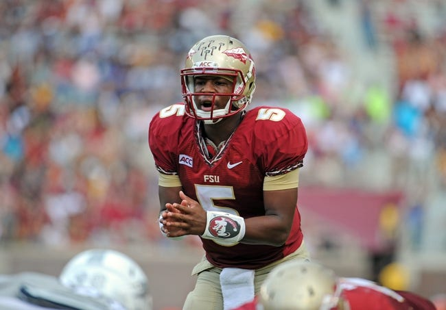 Sep 14, 2013; Tallahassee, FL, USA; Florida State Seminoles quarterback Jameis Winston (5) prepares to take the snap during the second half of the game against the Nevada Wolf Pack at Doak Campbell Stadium. Mandatory Credit: Melina Vastola-USA TODAY Sports