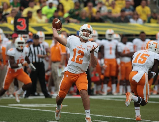 Sep 14, 2013; Eugene, OR, USA; Tennessee Volunteers quarterback Nathan Peterman (12) throws the ball in the second half against the Oregon Ducks at Autzen Stadium. Mandatory Credit: Scott Olmos-USA TODAY Sports