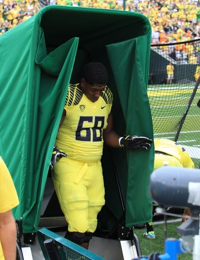 Sep 14, 2013; Eugene, OR, USA; Oregon Ducks newest field addition a portable potty for team players Oregon Ducks offensive linesman Jamal Prater (68) walks out of the folding potty against the Tennessee Volunteers at Autzen Stadium. Mandatory Credit: Scott Olmos-USA TODAY Sports