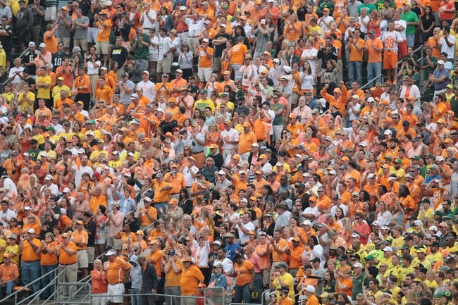 Sep 14, 2013; Eugene, OR, USA; Tennessee Volunteers fans cheer in the second half against the Oregon Ducks at Autzen Stadium. Mandatory Credit: Scott Olmos-USA TODAY Sports
