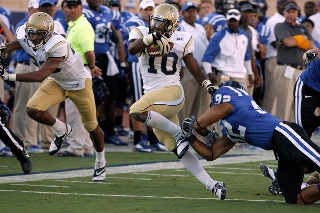 Sep 14, 2013; Durham, NC, USA; Georgia Tech Yellow Jackets running back Synjyn Days (10) runs past the tackle of Duke Blue Devils defensive end Justin Foxx (92) at Wallace Wade Stadium. Mandatory Credit: Mark Dolejs-USA TODAY Sports