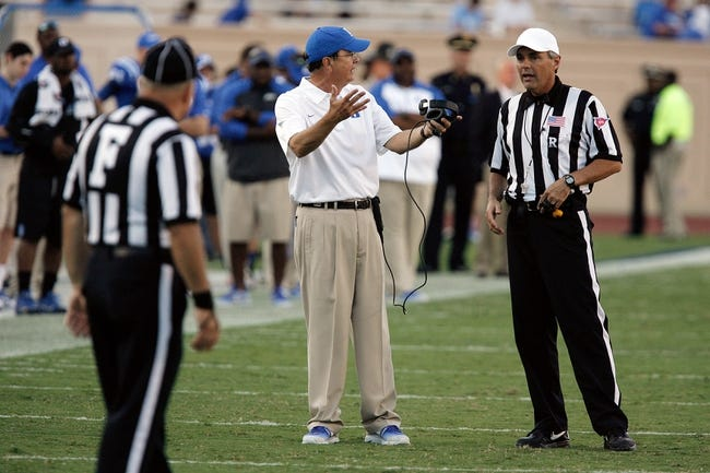 Sep 14, 2013; Durham, NC, USA; Duke Blue Devils head coach David Cutcliffe argues a call by the officials in their game against the Georgia Tech Yellow Jackets at Wallace Wade Stadium. Mandatory Credit: Mark Dolejs-USA TODAY Sports