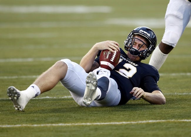 Sep 14, 2013; Miami, FL, USA; Florida International Panthers quarterback Jake Medlock (12) on the ground after a sack by Bethune Cookman Wildcats Rony Barrow (not pictured) in the second quarter at FIU Stadium. Mandatory Credit: Robert Mayer-USA TODAY Sports
