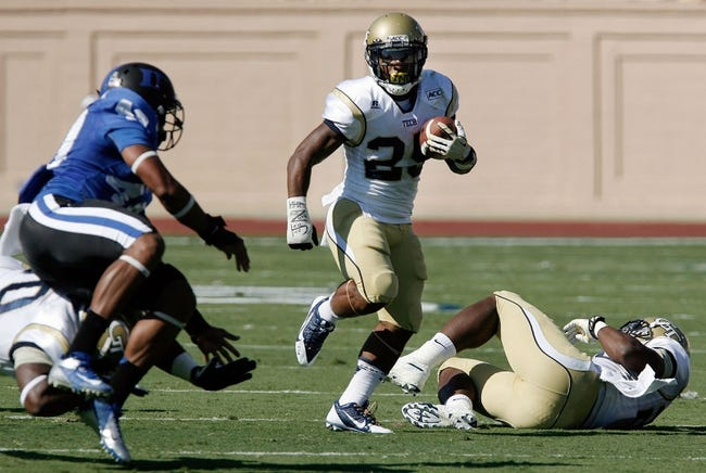 Sep 14, 2013; Durham, NC, USA; Georgia Tech Yellow Jackets running back Robert Godhigh (25) runs the ball against the Duke Blue Devils at Wallace Wade Stadium. Mandatory Credit: Mark Dolejs-USA TODAY Sports