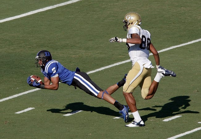Sep 14, 2013; Durham, NC, USA; Duke Blue Devils cornerback Ross Cockrell (6) intercepts the ball for a turnover in front of Georgia Tech Yellow Jackets wide receiver Darren Waller (88) at Wallace Wade Stadium. Mandatory Credit: Mark Dolejs-USA TODAY Sports