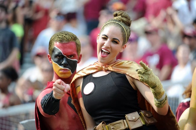 Sep 14, 2013; Tallahassee, FL, USA; Florida State Seminoles fans Chris Supernole and Mercy Joy Corlew cheer on their team during the game against the Nevada Wolf Pack at Doak Campbell Stadium. Mandatory Credit: Melina Vastola-USA TODAY Sports