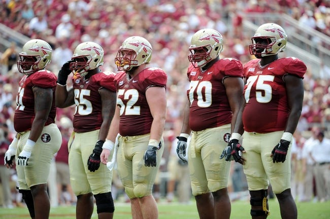 Sep 14, 2013; Tallahassee, FL, USA; Florida State Seminoles offensive lineman Bobby Hart (51), offensive lineman Ruben Carter (65), offensive lineman Brian Stork (52), offensive lineman Josue Matias (70) and offensive lineman Cameron Erving (75) during the first half of the game at Doak Campbell Stadium. Mandatory Credit: Melina Vastola-USA TODAY Sports