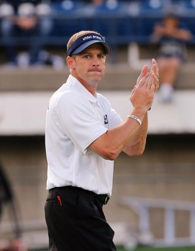 Sep 14, 2013; Logan, UT, USA; Utah State Aggies head coach Matt Wells during pre game warm up at Romney Stadium. Mandatory Credit: Chris Nicoll-USA TODAY Sports