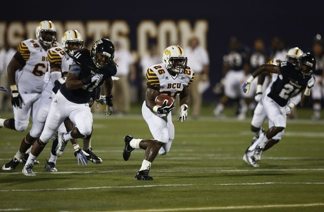 Sep 14, 2013; Miami, FL, USA; Bethune Cookman Wildcats running back Cary White (26) runs for a touchdown past Florida International Panthers defensive end Denzell Perine (11) in the third quarter at FIU Stadium. Mandatory Credit: Robert Mayer-USA TODAY Sports