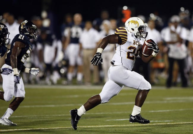 Sep 14, 2013; Miami, FL, USA; Bethune Cookman Wildcats running back Cary White (26) runs for a touchdown past Florida International Panthers cornerback Randy Harvey (21) in the third quarter at FIU Stadium. Mandatory Credit: Robert Mayer-USA TODAY Sports