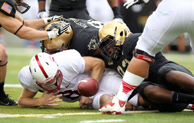 Sep 14, 2013; West Point, NY, USA; Stanford Cardinal quarterback Kevin Hogan (8) fumbles the ball after he was stripped by Army Black Knights defensive lineman Mike Ugenyi (92) at Michie Stadium. Mandatory Credit: Danny Wild-USA TODAY Sports