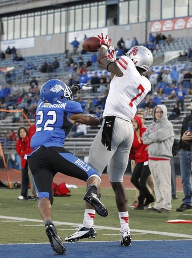 Sep 14, 2013; Buffalo, NY, USA; Stony Brook Seawolves defensive back Reuben Johnson (7) catches a pass in OT as Buffalo Bulls defensive back Najja Johnson (22) defends at University of Buffalo Stadium. Buffalo beats Stony Brook 26-23 in OT. Mandatory Credit: Kevin Hoffman-USA TODAY Sports