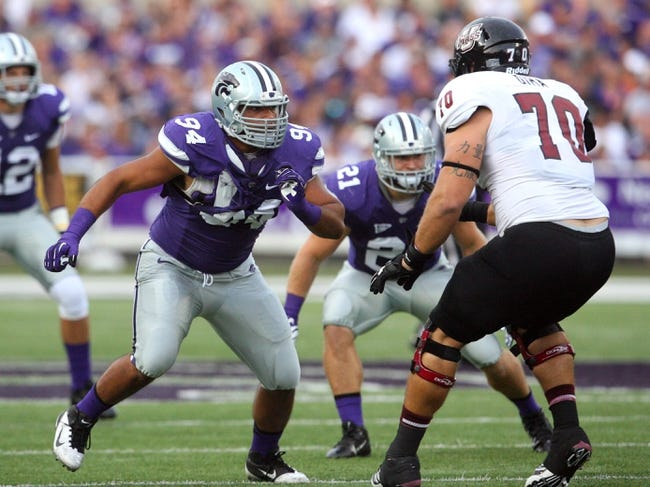 Sep 14, 2013; Manhattan, KS, USA; Kansas State Wildcats defensive end Alauna Finau (94) rushes against Massachusetts Minutemen offensive linesman Anthony Dima (70) during first-half action at Bill Snyder Family Stadium. Mandatory Credit: Scott Sewell-USA TODAY Sports