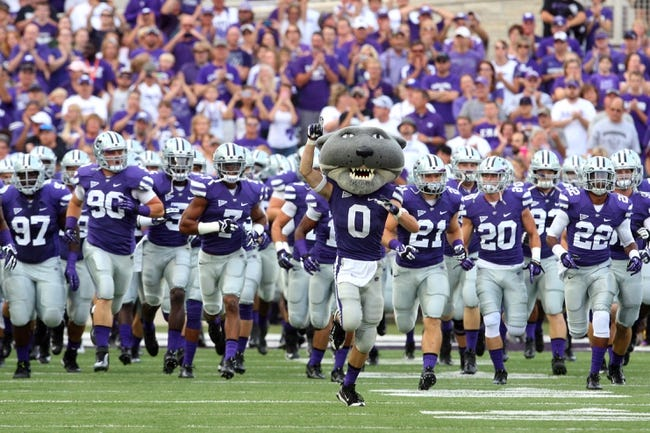 Sep 14, 2013; Manhattan, KS, USA; Kansas State Wildcats mascot Willie Wildcat leads the team onto the field before the start of a game against the Massachusetts Minutemen at Bill Snyder Family Stadium. Mandatory Credit: Scott Sewell-USA TODAY Sports