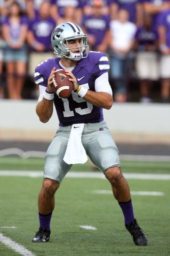 Sep 14, 2013; Manhattan, KS, USA; Kansas State Wildcats quarterback Jake Waters (15) drops back to pass during first-half action against the Massachusetts Minutemen at Bill Snyder Family Stadium. Mandatory Credit: Scott Sewell-USA TODAY Sports