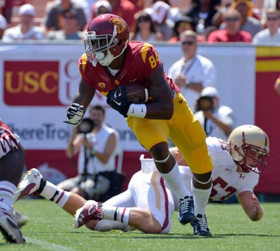 Sep 14, 2013; Los Angeles, CA, USA; USC Trojans wide receiver Darreus Rogers (84) slips past Boston College Eagles Leonard Skubal (53) during first half action at Los Angeles Memorial Coliseum. The Trojans went on to a 35-7 win. Mandatory Credit: Robert Hanashiro-USA TODAY Sports
