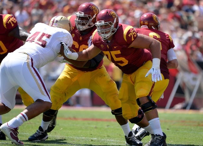 Sep 14, 2013; Los Angeles, CA, USA; USC Trojans guard Marcus Martin (66) and guard Max Tuerk (75) provide protection for quarterback Cody Kessler (6) blocking Boston College Eagles defensive lineman Mehdi Abdesmad (45)  during first half action at Los Angeles Memorial Coliseum. The Trojans went on to win 35-7.Mandatory Credit: Robert Hanashiro-USA TODAY Sports