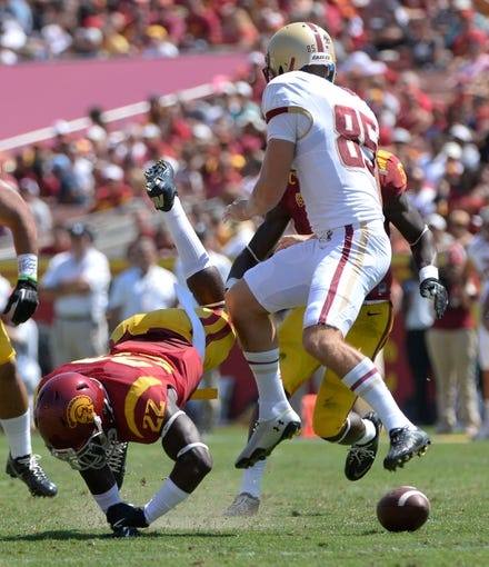 Sep 14, 2013; Los Angeles, CA, USA; USC Trojans safety Leon McQuay III (22) blocks a punt by Boston College Eagles kicker Nate Freese (85) during first half at the Los Angeles Memorial Coliseum. The play was nullified on a penalty. The Trojans went on to a 35-7 win over the Eagles. Mandatory Credit: Robert Hanashiro-USA TODAY Sports