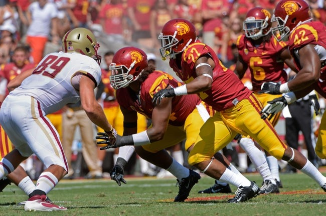 Sep 14, 2013; Los Angeles, CA, USA; USC Trojans defensive end Leonard Williams (94) and safety Gerald Bowman (27) come off the line of scrimmage during third quarter action at Los Angeles Memorial Coliseum. Left is Boston College Eagles tight end Mike Naples (89). Mandatory Credit: Robert Hanashiro-USA TODAY Sports