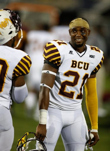 Sep 14, 2013; Miami, FL, USA; Bethune Cookman Wildcats defensive back Tim Burke (21) on the sidelines after an interception for a touchdown in the fourth quarter against the Florida International Panthers at FIU Stadium. The Wildcats won 34-13. Mandatory Credit: Robert Mayer-USA TODAY Sports