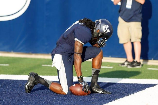 Sep 14, 2013; Logan, UT, USA; Utah State Aggies wide receiver Travis Reynolds (8) after scoring a touchdown at Romney Stadium. Mandatory Credit: Chris Nicoll-USA TODAY Sports
