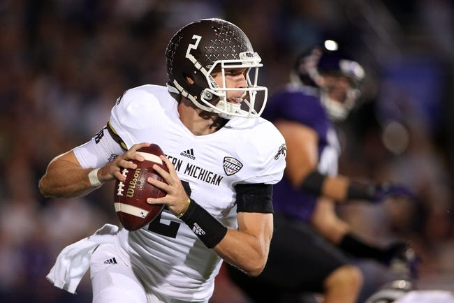 Sep 14, 2013; Evanston, IL, USA; Western Michigan Broncos quarterback Tyler Van Tubbergen (2) scrambles during the first quarter against the Northwestern Wildcats at Ryan Field. Mandatory Credit: Jerry Lai-USA TODAY Sports