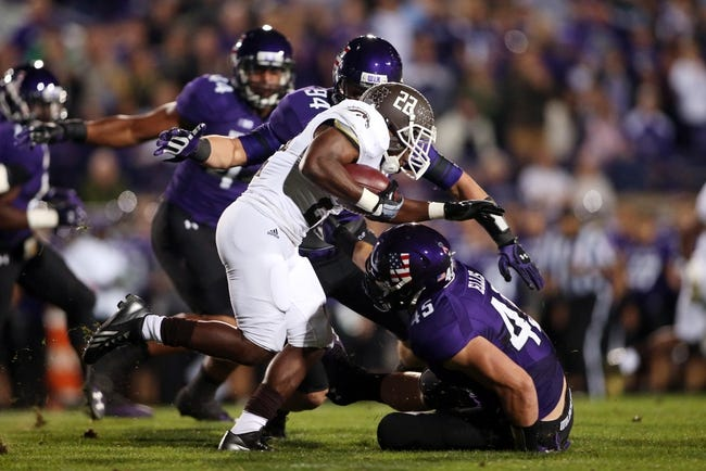 Sep 14, 2013; Evanston, IL, USA; Western Michigan Broncos running back Dareyon Chance (22) is tackled by Northwestern Wildcats defensive lineman Dean Lowry (94) and linebacker Collin Ellis (45) during the first quarter at Ryan Field. Mandatory Credit: Jerry Lai-USA TODAY Sports