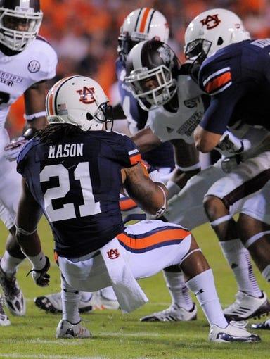 Sep 14, 2013; Auburn, AL, USA; Auburn Tigers running back Tre Mason (21) is met with Mississippi State Bulldogs defense at Jordan Hare Stadium. Mandatory Credit: Shanna Lockwood-USA TODAY Sports