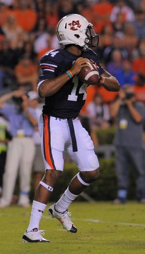 Sep 14, 2013; Auburn, AL, USA; Auburn Tigers quarterback Nick Marshall (14) looks to pass against the Mississippi State Bulldogs at Jordan Hare Stadium. Mandatory Credit: Shanna Lockwood-USA TODAY Sports