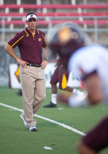 Sep 14, 2013; Las Vegas, NV, USA; Central Michigan Chippewas head coach Dan Enos watches his team warm up before an NCAA football game against UNLV at Sam Boyd Stadium. Mandatory Credit: Stephen R. Sylvanie-USA TODAY Sports