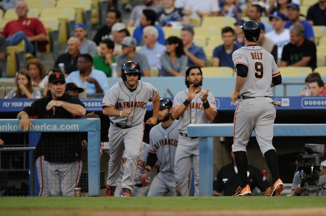 Sep 14, 2013; Los Angeles, CA, USA; San Francisco Giants first baseman Brandon Belt (9) celebrates with his team after running in a score against the Los Angeles Dodgers during the first inning at Dodger Stadium. Mandatory Credit: Kelvin Kuo-USA TODAY Sports