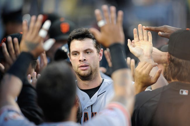 Sep 14, 2013; Los Angeles, CA, USA; San Francisco Giants first baseman Brandon Belt (9) celebrates after running in a score against the Los Angeles Dodgers during the second inning at Dodger Stadium. Mandatory Credit: Kelvin Kuo-USA TODAY Sports