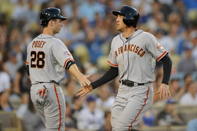 Sep 14, 2013; Los Angeles, CA, USA; San Francisco Giants right fielder Hunter Pence (8) celebrates with San Francisco Giants catcher Buster Posey (28) after running in a score against the Los Angeles Dodgers during the second inning at Dodger Stadium. Mandatory Credit: Kelvin Kuo-USA TODAY Sports