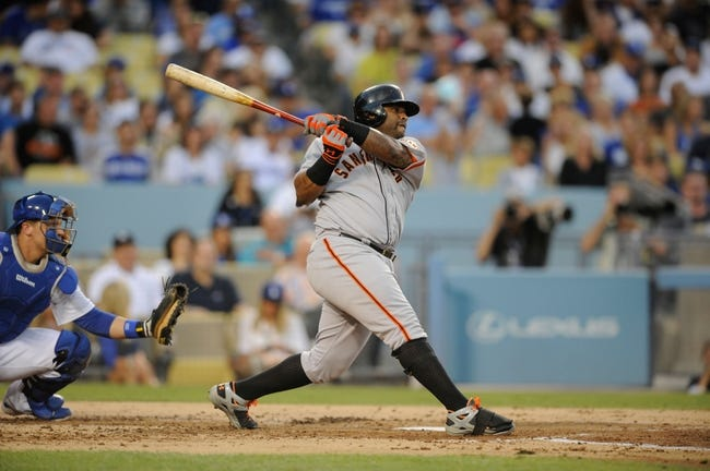 Sep 14, 2013; Los Angeles, CA, USA; San Francisco Giants third baseman Pablo Sandoval (48) hits a double against the Los Angeles Dodgers during the second inning at Dodger Stadium. Mandatory Credit: Kelvin Kuo-USA TODAY Sports