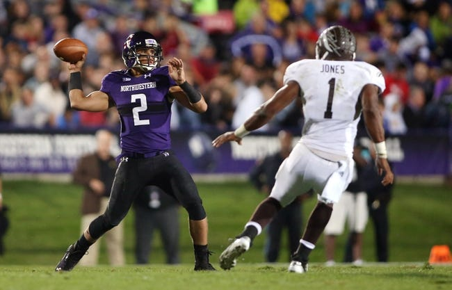 Sep 14, 2013; Evanston, IL, USA; Northwestern Wildcats quarterback Kain Colter (2) throws a pass against Western Michigan Broncos linebacker Mike Jones (1) during the second quarter at Ryan Field. Mandatory Credit: Jerry Lai-USA TODAY Sports
