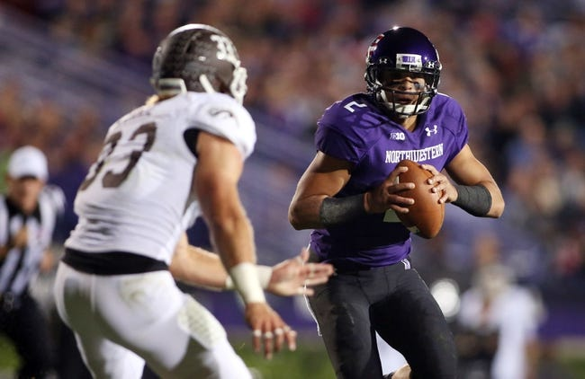 Sep 14, 2013; Evanston, IL, USA; Northwestern Wildcats quarterback Kain Colter (2) runs against Western Michigan Broncos safety Justin Currie (33) during the second quarter at Ryan Field. Mandatory Credit: Jerry Lai-USA TODAY Sports