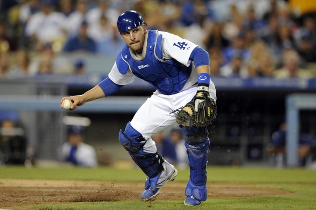 Sep 14, 2013; Los Angeles, CA, USA; Los Angeles Dodgers catcher Tim Federowicz (18) fields a ball hit by San Francisco Giants short stop Brandon Crawford (not pictured) during the fourth inning at Dodger Stadium. Mandatory Credit: Kelvin Kuo-USA TODAY Sports