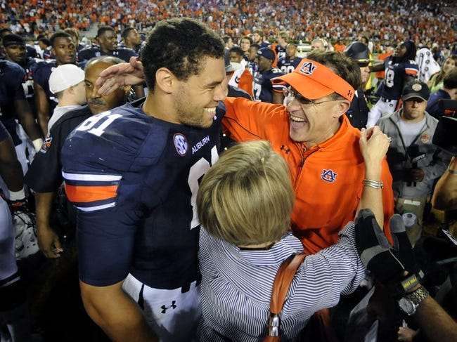 Sep 14, 2013; Auburn, AL, USA; Auburn Tigers tight end C.J. Uzomah (81) and head coach Gus Malzahn celebrate after the game against the Mississippi State Bulldogs at Jordan Hare Stadium. The Tigers defeated the Bulldogs 24-20. Mandatory Credit: Shanna Lockwood-USA TODAY Sports
