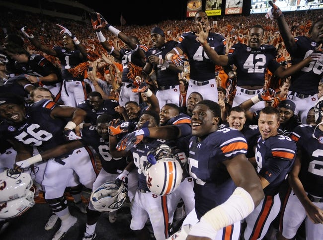 Sep 14, 2013; Auburn, AL, USA; Auburn Tigers players celebrate with fans after the game against the Mississippi State Bulldogs at Jordan Hare Stadium. The Tigers defeated the Bulldogs 24-20. Mandatory Credit: Shanna Lockwood-USA TODAY Sports