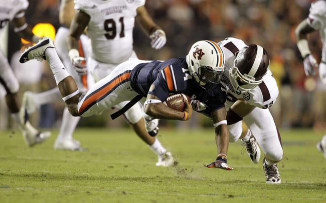 Sep 14, 2013; Auburn, AL, USA; Auburn Tigers quarterback Nick Marshall (14) is tackled by  Mississippi State Bulldog linebacker Richie Brown (39) during the second half at Jordan Hare Stadium.  The Tigers beat the Bulldogs 24-20.  Mandatory Credit: John Reed-USA TODAY Sports