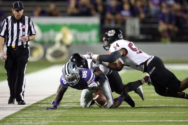 Sep 14, 2013; Manhattan, KS, USA; Kansas State Wildcats wide receiver Tramaine Thompson (86), Massachusetts Minutemen defensive back Ed Saint-Vil (6) and defensive lineman Trey Seals (54) go after a loose ball during the Wildcats' 37-7 win at Bill Snyder Family Stadium. Thompson recovered the ball. Mandatory Credit: Scott Sewell-USA TODAY Sports