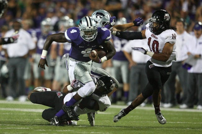 Sep 14, 2013; Manhattan, KS, USA; Kansas State Wildcats quarterback Daniel Sams (4) is tackled by Massachusetts Minutemen defensive backs Trey Dudley-Giles (9) and Devin Brown (10) during the Wildcats' 37-7 win at Bill Snyder Family Stadium. Mandatory Credit: Scott Sewell-USA TODAY Sports