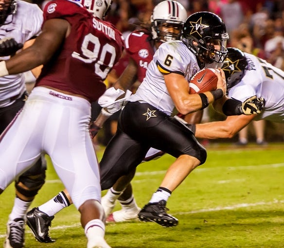 Sep 14, 2013; Columbia, SC, USA; Vanderbilt Commodores quarterback Austyn Carta-Samuels (6) rushes for a touchdown against the South Carolina Gamecocks in the second half at Williams-Brice Stadium. Mandatory Credit: Jeff Blake-USA TODAY Sports