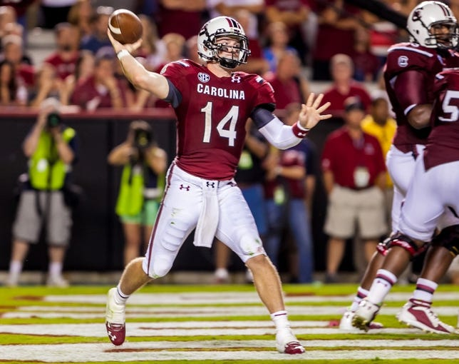 Sep 14, 2013; Columbia, SC, USA; South Carolina Gamecocks quarterback Connor Shaw (14) passes from the end zone against the Vanderbilt Commodores in the second half at Williams-Brice Stadium. Mandatory Credit: Jeff Blake-USA TODAY Sports