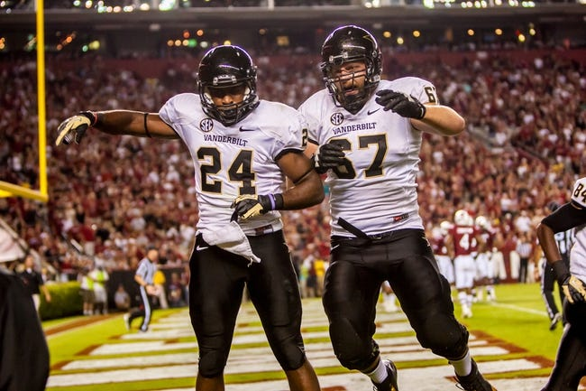 Sep 14, 2013; Columbia, SC, USA; Vanderbilt Commodores running back Wesley Tate (24) and Vanderbilt Commodores offensive linesman Wesley Johnson (67) celebrate a touchdown against the South Carolina Gamecocks in the second half at Williams-Brice Stadium. Mandatory Credit: Jeff Blake-USA TODAY Sports